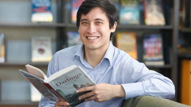 man smiling with book