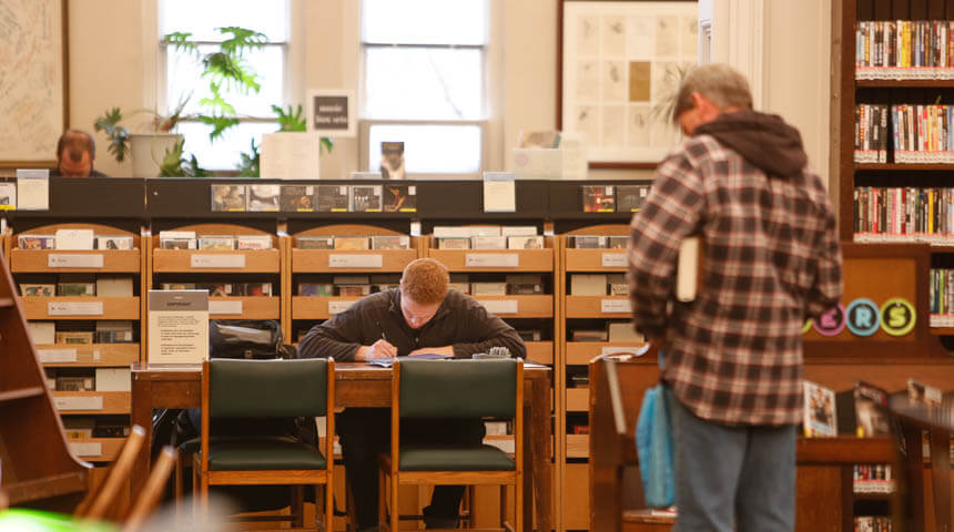 People browsing in Music Department of CLP-Main in Oakland