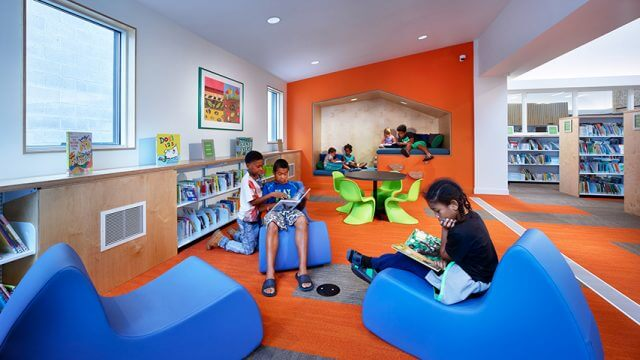 Children reading in CLP-Knoxville children's space after 2016 renovation project