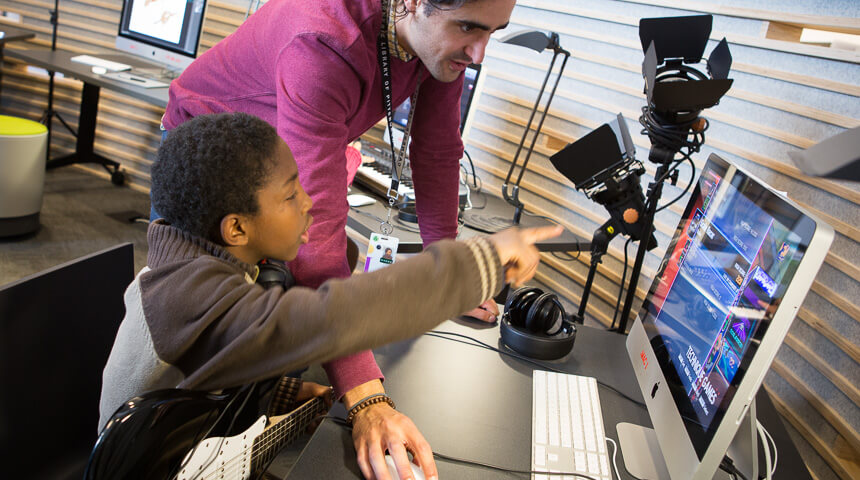 Man helping child on the computer