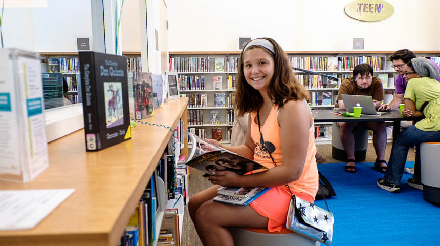 teen girl smiling with book