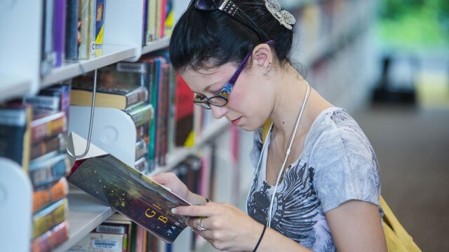 Teen reading in the library