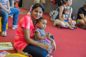 A parent and child enjoy Bilingual Storytime at CLP - Squirrel Hill.