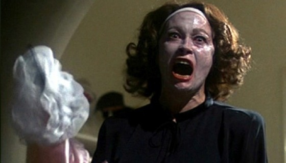 Image of Faye Dunaway portraying actress Joan Crawford in the infamous wire hanger scene from Mommie Dearest