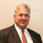 Portrait photo of board member DeMarco