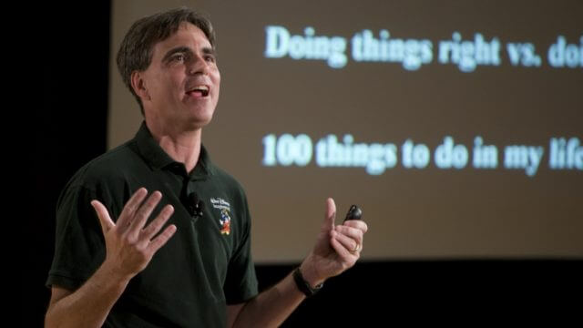 Randy Pausch giving a talk in front of presentation screen