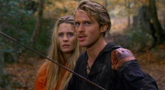 Westley protects Buttercup, his sword drawn.
