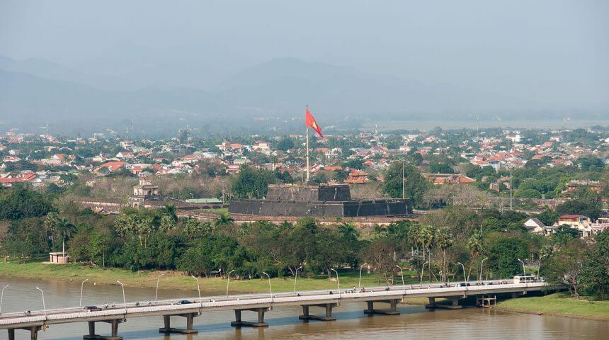 The Perfume River (Hương Giang) and the Phú Xuân Bridge at Huế, where author Andrew Lam lived as a child.