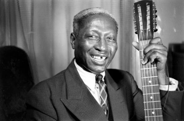 """Huddie """"Leadbelly"""" Ledbetter with a 12 string guitar"""