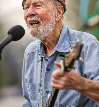 Pete Seeger playing a banjo and singing