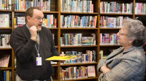 Librarian helping a patron