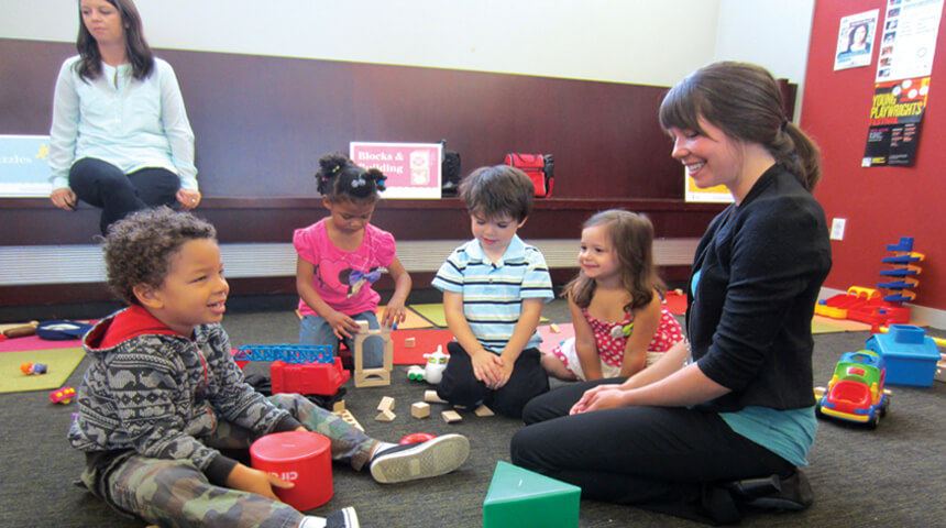 kids and caregiver playing together