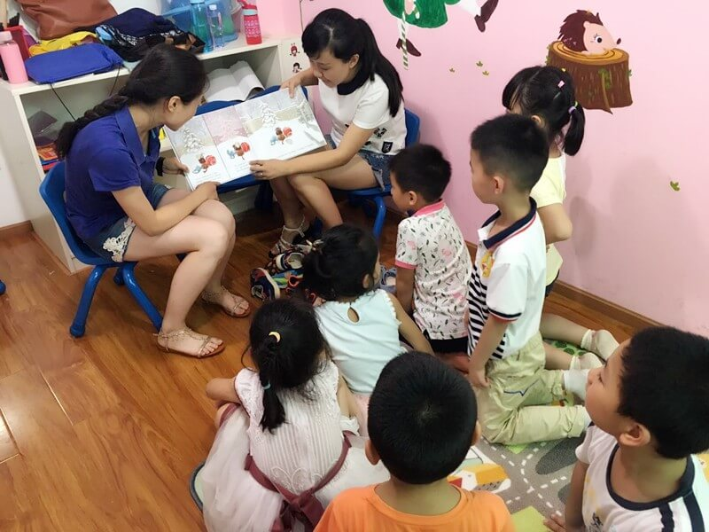 "Katrina and Dutian share the book, ""Toys Meet Snow"" from CLP with a group of kids"
