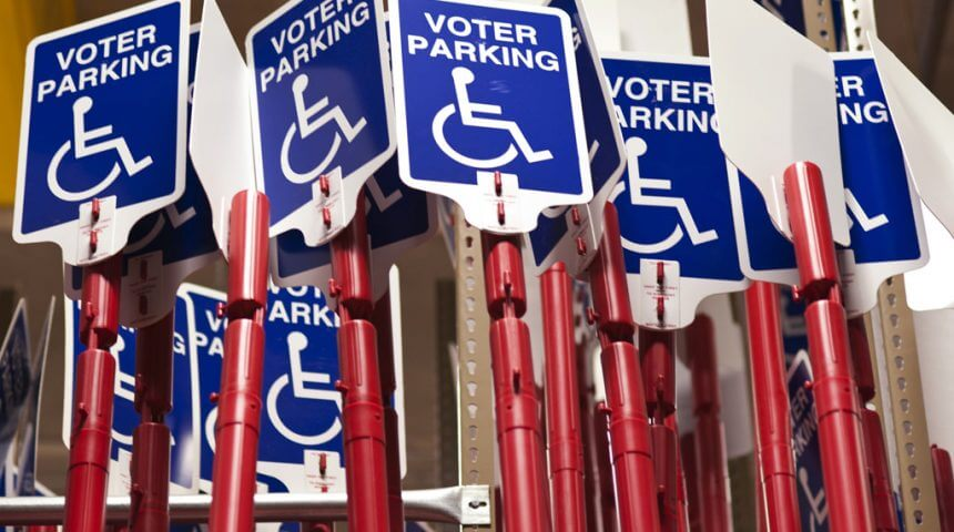 Photo of disabled voter parking signs are stored inside the Maricopa County Elections Department warehouse in Phoenix. The signs provide access for disabled voters at polling locations in Maricopa County. Photo by Jeremy Knop/News21