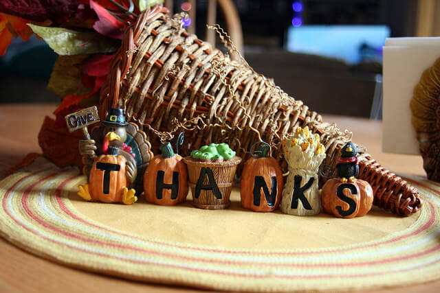 """Picture of a cornucopia with a turkey that says """"Give Thanks"""""""