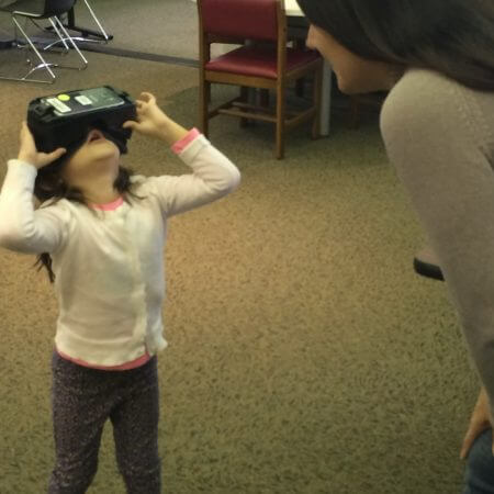 A mother and daughter exploring virtual reality at a VR Walk-In Open Play.