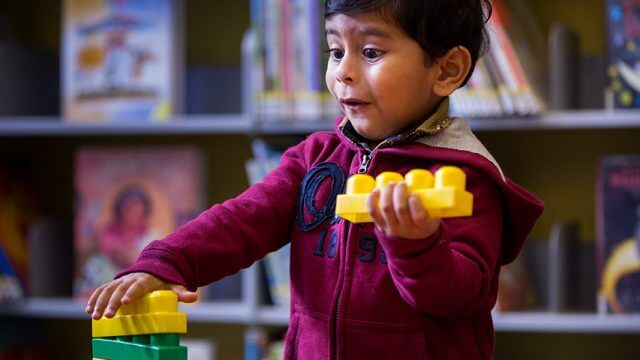 Child playing with blocks in the Library