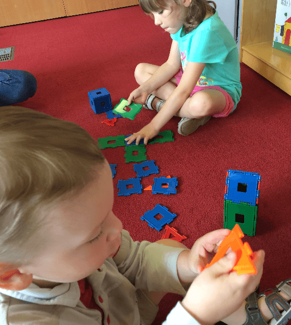 Children play with toys from a Playscape kit at CLP - Squirrel Hill