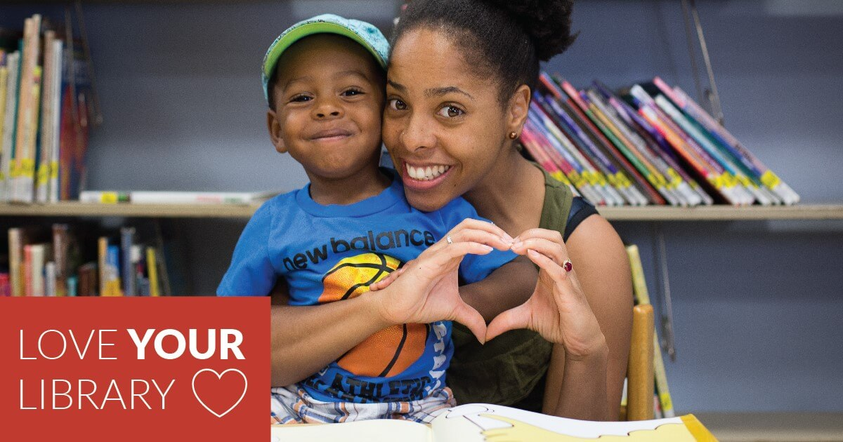parent and child making a heart shape with their hands