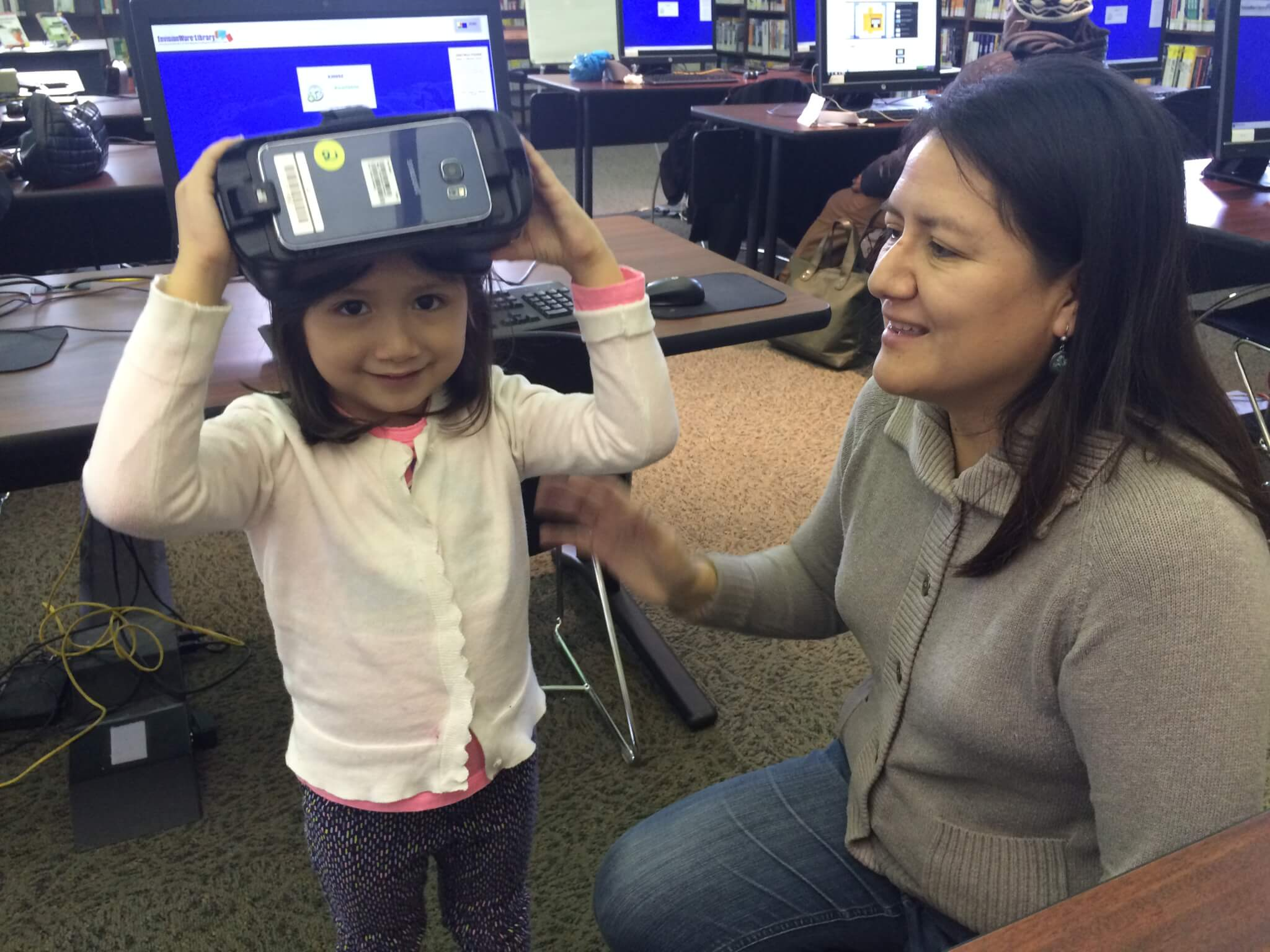 A young child trying on CLP's virtual reality equipment.