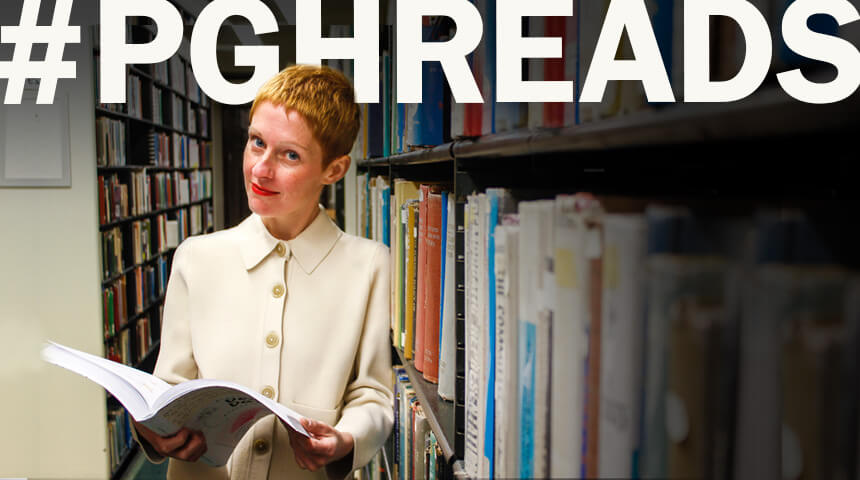 """Author Giorgia Lupi posing with a copy of their book """"Dear Data"""" in library stacks below text """"Hashtag PGH Reads."""""""