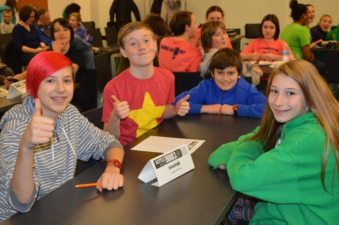 Teens at a team table at a Battle of the Books reading competition.
