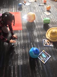 Girl explores solar system.