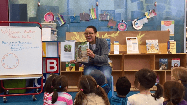 Local author, Shana Keller reads her book to a group of children.