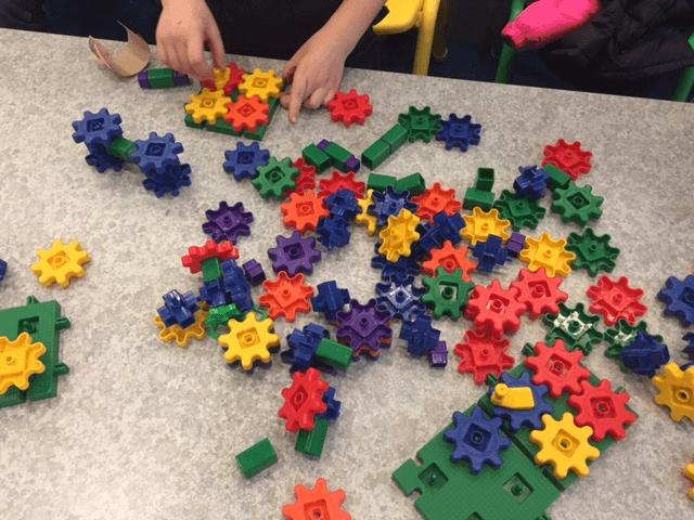 Children explore gears.