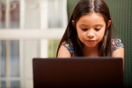 Young child works on a laptop computer