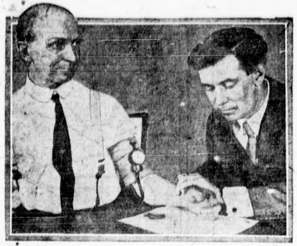 Dr. Marston (right) testing his blood pressure test as pictured in a 1922 newspaper photo.