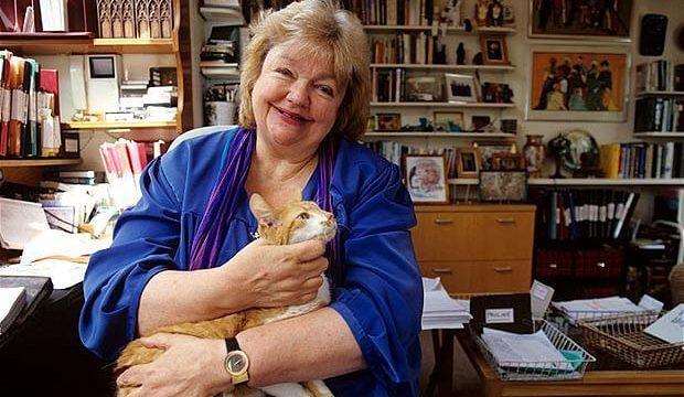 Photo of Maeve Binchy in her office with an orange tabby cat.
