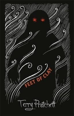 Alternative Cover Art of Feet of Clay featuring a dark Golem figure with glowing red eyes