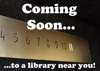 """Elevator floor panel with illuminated number eleven with text """"Coming soon to a library near you!"""""""