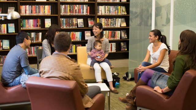library patrons sitting in a language learning circle
