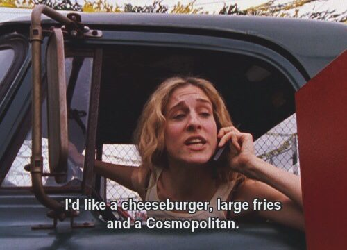Carrie Bradshaw, character of Sex in the City, orders a cheeseburger, large fries, and a Cosmopolitan at a drive thru