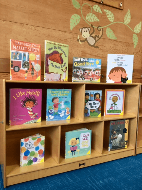 "A book display featuring books from the ""Here to Help"" booklists."