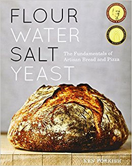 Cover of Forkish's book, featuring a large, round loaf of bread