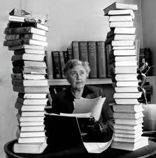 A photo of Agatha Christie surrounded by books.