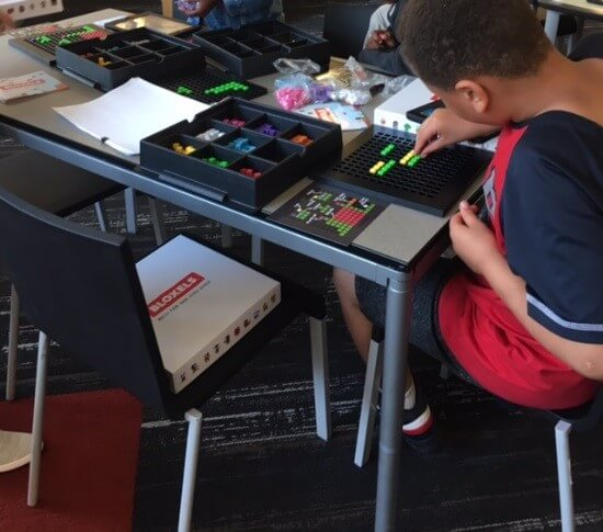Child using Bloxels at the Library.