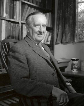 A Photo of the author, JRR Tolkien sitting in a study, smiling
