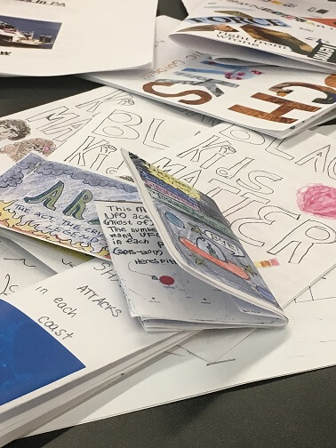A table full of data zines made by teens during the Data Zines Lab at CLP Squirrel Hill