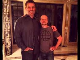 Authors Tony Robbins and Tim Ferriss standing together.