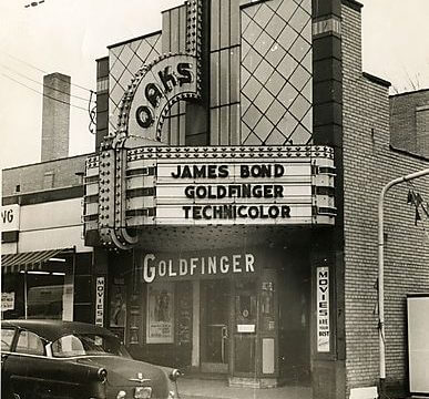 "Image from 1964 of the Oaks Theater marquee advertising the James Bond film ""Goldfinger."""