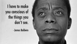 "James Baldwin photo with quote ""I have to make you conscious of the things you don't see)"