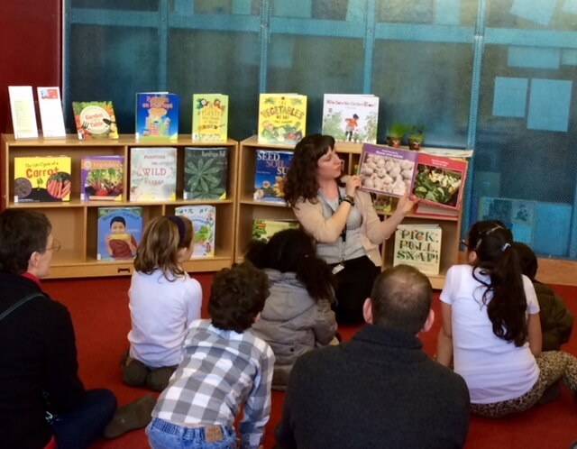 Reading a book during a school age program.