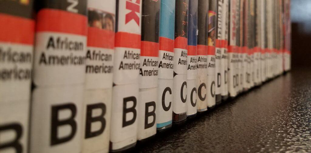 DVDs with African American genre stickers.