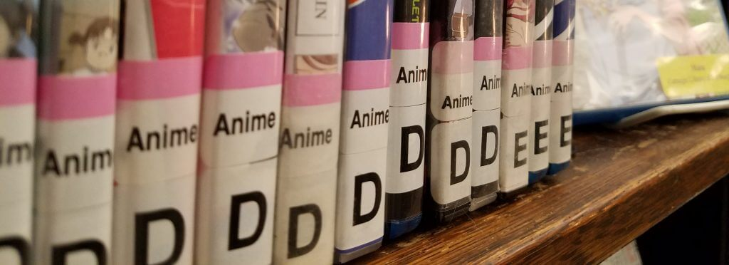 DVDs with Anime genre stickers.