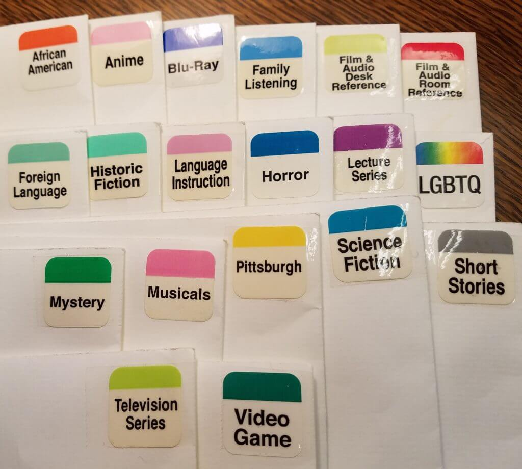 Genre stickers in envelopes.