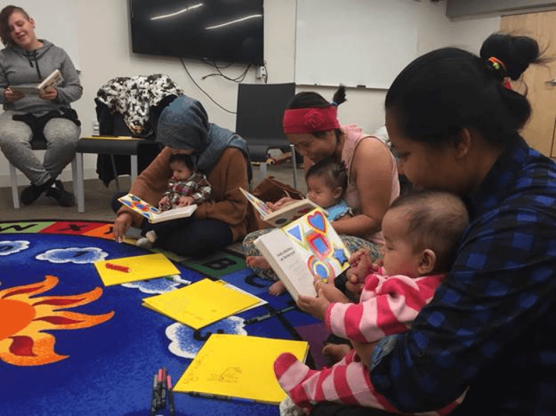 Babies, parents and expecting parents shared a group read aloud with their little ones at CLP – Knoxville's Baby Book Shower in November 2017.